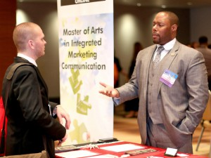 PRSSA member Adam Piccin networking at the PRSSA 2015 National Conference Career Exhibition.