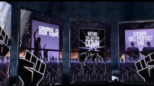 Concept art featuring a stage with rasied fist symbol in the middle. Silhouette figures surround the stage.