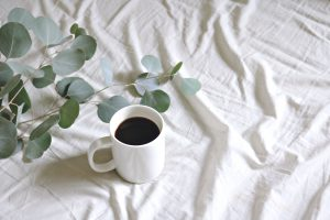 White coffee mug on table with white tablecloth