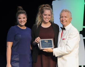 University of Omaha-Nebraska's PRSSA Chapter accepts its Teahan Award for Community Service.
