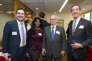 New public relations professional, Mike DeFilippis (far right), poses with (left to right) Robert Schneider, Aarthi Gunasekaran and Robert A. Brown at a Boston University open house event in April. Photo courtesy of Mike Defilippis.