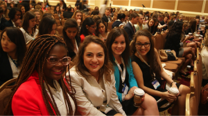 Conference attendees pose for a photo amidst a day of sessions and networking. | Courtesy of PRSSA National.