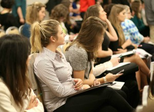 Students taking notes and tweeting quotes at a National Conference session.