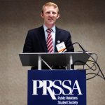 Andrew Cook behind a PRSSA podium