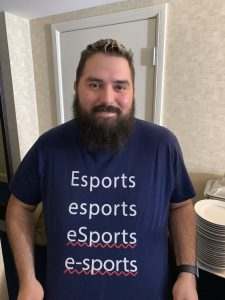 photo of Rishi Chadha wearing a tshirt with various spellings of esports